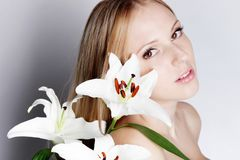 Girl with lily flower Stock Images