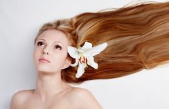 Girl with lily flower in hair Royalty Free Stock Photos