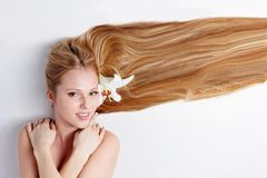 Girl with lily flower in hair Stock Photography