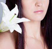 Girl with lily flower on shouder Royalty Free Stock Images