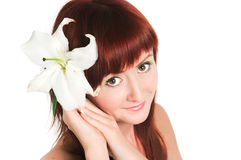 Girl with a lily flower Royalty Free Stock Image