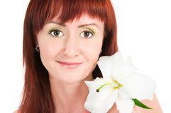The girl with a lily flower Stock Photos