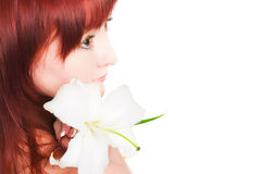 The girl with a lily flower Stock Image