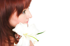 The girl with a lily flower Royalty Free Stock Photography