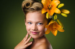 Girl with lily flowers in hair Stock Photo