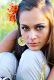 Girl with lily in her hair Stock Photography