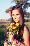 Girl with lily outdoors, cross Stock Photos