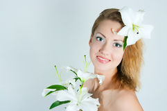 Girl with a lily Royalty Free Stock Images
