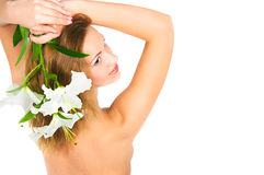 Girl with a lily Stock Photos