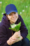 Girl with lily of the valley Royalty Free Stock Photo