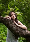 Girl with Lily of the valley chaplet Royalty Free Stock Photo