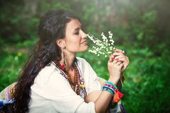 Girl with lily of the valley Royalty Free Stock Photos