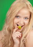 Girl with lime Royalty Free Stock Images