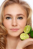 Girl with limes Stock Photo