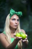 Girl with limes in her hands. Royalty Free Stock Images