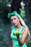 Girl with limes in her hands. Royalty Free Stock Photos