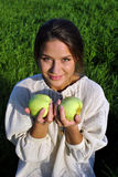 Girl in a linen shirt, holding apples Royalty Free Stock Photo