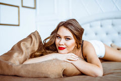 Girl in lingerie on the bed Royalty Free Stock Photography