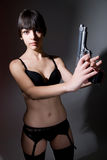 Girl in lingerie with a gun Royalty Free Stock Photo