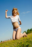 Girl in lingerie in a jump Royalty Free Stock Image