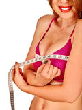Girl in lingerie measures her breast measuring tape. Royalty Free Stock Photos