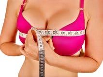 Girl in lingerie measures her breast measuring Stock Photos
