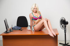 Girl in lingerie on the office desk Royalty Free Stock Photos