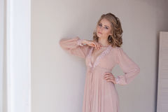 Girl in lingerie Pajamas pink Stock Photos
