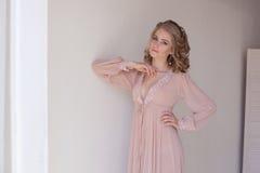 Girl in lingerie Pajamas pink Stock Photos
