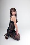 Girl in lingerie posing on her knees Stock Photography