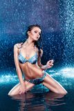 Girl in lingerie in the rain Royalty Free Stock Image