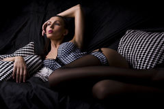 Girl in lingerie at sofa Royalty Free Stock Photos