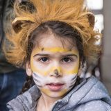Girl with lion masquerade stock photos