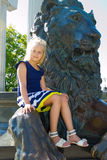 Girl and the lion Stock Photography