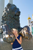 Girl and the lion Royalty Free Stock Photo