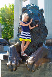 Girl and the lion Royalty Free Stock Image