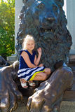 Girl and the lion Royalty Free Stock Images