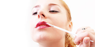 Girl with lip-liner Royalty Free Stock Photos