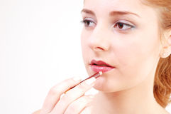 Girl with lip-stick stock photos