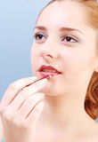 Girl with lip-stick Stock Images