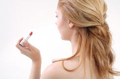 Girl with lip-stick Royalty Free Stock Photography