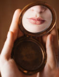 Girl lips in a mirror Stock Photography