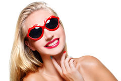 Girl in lips shaped sunglasses. Beautiful happy young woman in lips shaped sunglasses. Isolated over white background. Copy space Royalty Free Stock Photos