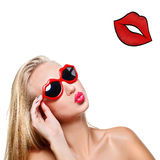 Girl in lips shaped sunglasses. Beautiful young woman in lips shaped red sunglasses. Kissing mouth. Lips drawing. Isolated over white background. Copy space royalty free stock photos