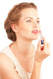 Girl with lipstick Royalty Free Stock Image