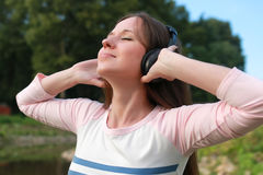 Girl listen music in headphone outdoor Royalty Free Stock Photos