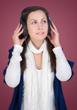 Girl listen music in headphones Royalty Free Stock Images