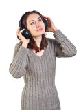 Girl listen to big headphones Stock Photography