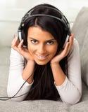 Girl listen to music Stock Images