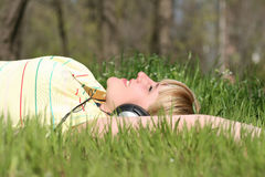 Girl listen to music Royalty Free Stock Photography